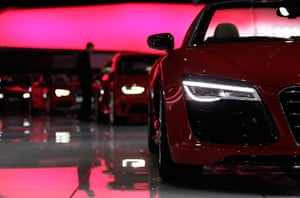 Geneva motor show: A staff cleans cars on the Audi stand