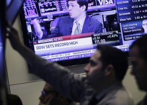 Stock traders work at the New York Stock Exchange, Tuesday, March 5, 2013 in New York.