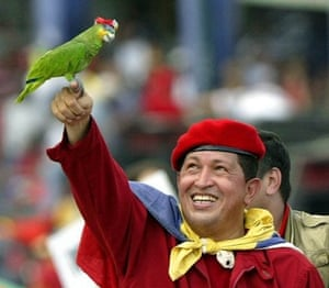 Venezuelan president Hugo Chavez holds up a parrot