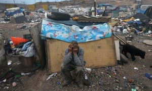 Former immigrant Arturo Santana sits in front of his modest home at the Tirabichi garbage dump in Nogales, Mexico. Santana had been living and working in Iowa when he was picked up and deported by U.S. Customs agents. About 30 families live at the landfill, searching for recyclables to sell for a living.