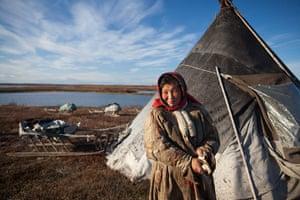 A Nenets woman outside her chum, or teepee, in Siberia's Yamal Peninsula