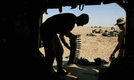 Spc Travis Hunter loads armor-piercing depleted uranium-tipped shells during the second Iraq war