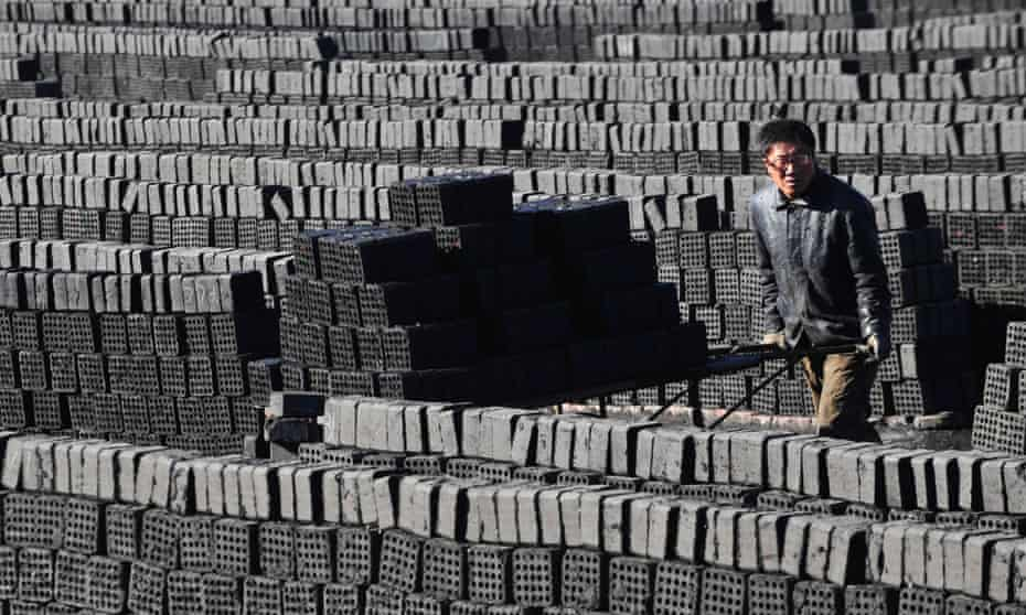 A worker pushes a cart at a coal factory in Shenyang, Liaoning province, March 5, 2013. China's new rulers will focus on consumer-led growth to narrow the gap between rich and poor while taking steps to curb pollution and graft, the government said on Tuesday, tackling the main triggers for social unrest in the giant nation. REUTERS/Stringer (CHINA - Tags: BUSINESS ENERGY POLITICS) :rel:d:bm:GF2E9350QCP01