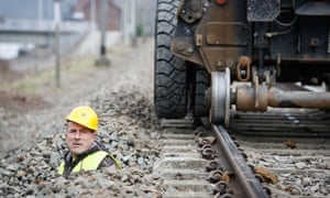 A man works checks what will be the first ETCS (European Train Control System) line, in Profondeville, Belgium. The modernisation of the line, between Jambes and Dinant will enable the system to automatically stop a train that neglects a red light or exceeds the maximum speed limit.