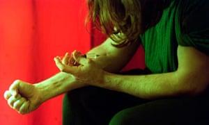Men injecting heroin
