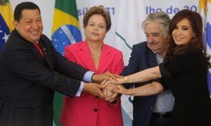 Venezuelan President Hugo Chavez (L) and his counterparts of Brazil Dilma Rousseff (2L), of Uruguay Jose Mujica (2R) and of Argentina Cristina Fernandez de Kirchner (R)