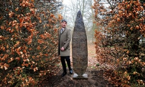 William Turnbulls's son Alex Turnbull walks past at a William Turnbull sculpture named Queen 2 in the grounds at Chatsworth House. Derbyshire.