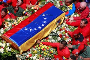 The flag-draped coffin containing the body of Venezuela's late President Hugo Chavez is taken from the hospital where he died, to a military academy, where it will remain until his funeral in Caracas, Venezuela. Photograph: Ricardo Mazalan/AP