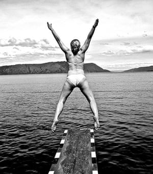 Inpics-leap: black and white pic of girl leaping off diving board
