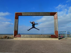 Inpics-leap: girl jumping inside frame against blue sky
