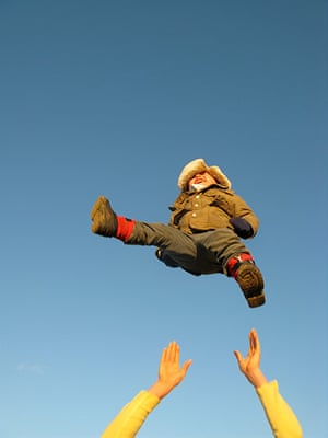 Inpics-leap: boy in hat being thrown in air