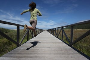 Inpics-leap: girl running along wooden bridge