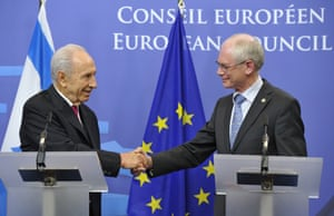 European Union Council President Herman Van Rompuy (R) and President of Israel Shimon Peres shake hands at a joint press conference after their working session on March 6, 2013 at the EU Headquarters in Brussels. Photograph: Georges Gobet/AFP/Getty Images