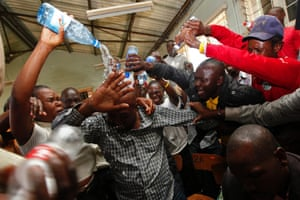 Supporters of the Orange Democratic Movement (ODM) and its leader and presidential aspirant Prime Minister Raila Odinga celebrate after their candidate won in the County Representative elections, at a tallying center near the Mathare slum, Nairobi, Kenya. Photograph: Dai Kurokawa/EPA
