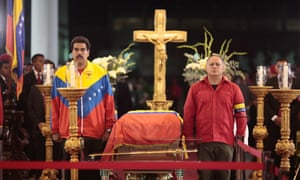 Nicolas Maduro (left), Venezuela's vice-president and acting president,  and Diosdado Cabello, the president of the National Assembly, stand next to Hugo Chavez's coffin in Caracas  on 6 March 2013.