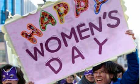 The Korean Women's Association United attend a flash mob for International Women's Day