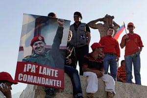"Hugo Chavez funeral: Supporters hold a poster reading in Spanish ""Move forward commander!"""