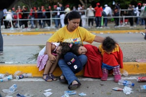 Hugo Chavez funeral: A woman sits with her children