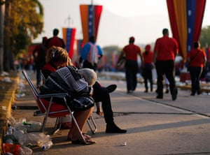 Hugo Chavez funeral: People rest after having spent the entire night to view his body in state