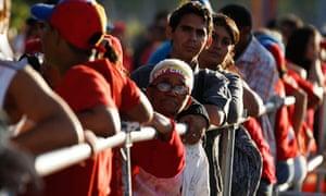 Chavez funeral: Supporters of Venezuela's late President Hugo Chavez wait