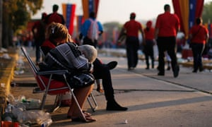 Chavez funeral: Supporters rest after having spent the entire night waiting