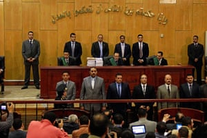 Judges from the Port Said criminal court give their verdict in Cairo, where the hearing was held for security reasons