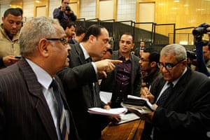 Lawyers for the defendants confer after the Port Said criminal court gave its verdict