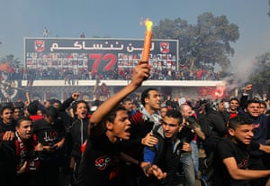 Fans of al-Ahly celebrate outside their stadium in Cairo, Egypt