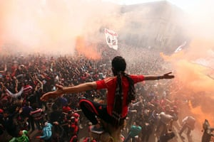 Al-Ahly fans celebrate in Cairo after a court confirmed the death penalty for 21 rioters