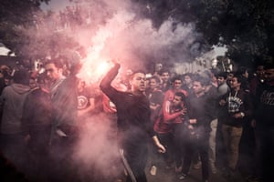 Supporters of the Cairo-based al-Ahly football club react to the verdict.