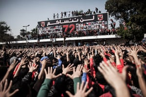 Al-Ahly supporters in Cairo, Egypt, react to the verdict