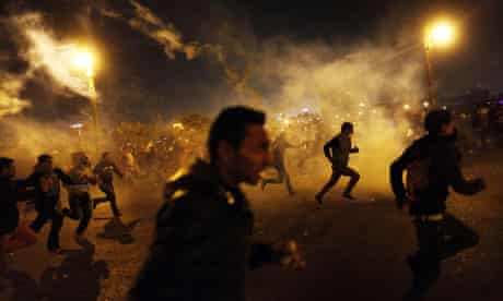 Egyptian protesters run for cover