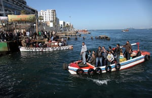 Port Said: Men ride in fishing boats to cross to the other side of the Suez Canal