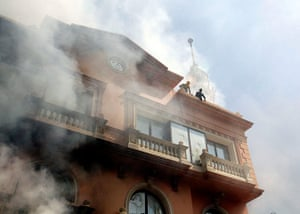 Port Said: Egyptian policemen wait to be rescued after a fire to a police cl