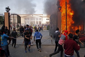 Port Said: Al-Ahly club supporters run away from smoke and flames