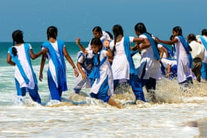 Readers' travel March: India, girls paddling
