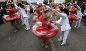 Dancers perform at a March for Peace held in Bogotá to support continuing talks