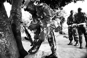 Minova DRC rape: A soldier polishes his boots before morning prayers