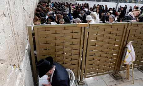 Women praying on one side of a partition at the Western Wall in Jerusalem