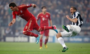 Bayern Munich's Mario Mandzukic and Giorgio Chiellini of Juventus