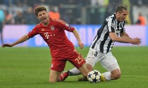 Bayern Munich's Thomas Müller and Giorgio Chiellini of Juventus
