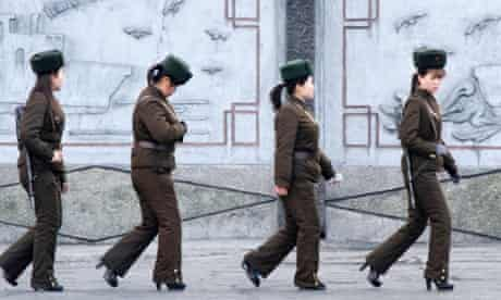 Female North Korean soldiers on patrol along the banks of Yalu River, near the North Korean town of Sinuiju, opposite the Chinese border city of Dandong.