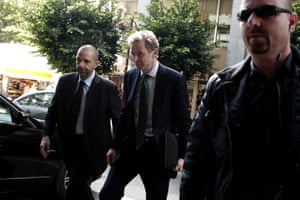 International Monetary Fund (IMF) mission chief Poul Thomsen, center,  arrives for a meeting between Greek Finance Minister Yannis Stournaras and the debt inspectors from the European Central Bank, European Commission and International Monetary Fund, known as the troika, in Athens, Thursday, April 11, 2013.