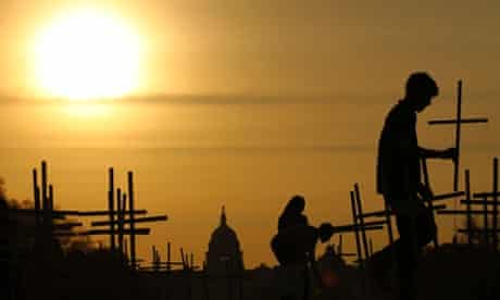 The sun rises above the US Capitol as volunteers place crosses, symbolising grave markers, on the National Mall in Washington. A 24-hour vigil is being held featuring a gathering of Newtown clergy and 3,300 grave markers to 'remind Congress action is needed on gun violence prevention'. The number 3,300 represents the supposed number of people who have died as a result of gun violence since the tragedy at the school in Newtown, Connecticut.