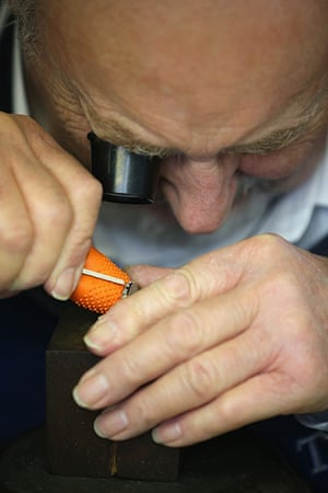 FTA: Christopher Furlong: A craftsman hand engraves the edge of a medal