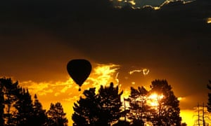 Hot air balloon in flight at sunset