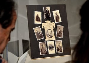Civil war photography: People look at a display called In Memory of Abraham Lincoln, 1865