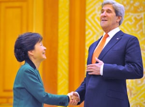 Here's lookig (up) to you: South Korean President Park Geun-Hye US Secretary of State John Kerry shake hands before their talks at the presidential Blue House in Seoul.