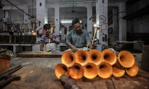 Craftsmen work on instruments at Nadir Ali & Company in Uttar Pradesh, India. Meerut, a city about 50 miles from New Delhi, is home to many musical instrument manufacturers.