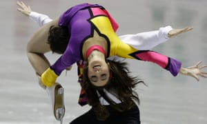 Is that a Mondrian-inspired outfit? Cathy Reed and Chris Reed of Japan perform during the ice dance free dance at the ISU World Team Trophy in Figure Skating in Tokyo.